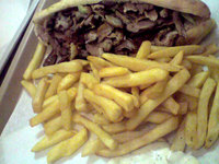Grec frites - La porte St Denis à Paris - Photo 6